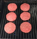 Put the stuffed burgers on the grill